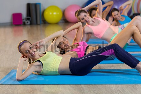 Smiling people doing stretching exercise in gym Stock photo © wavebreak_media