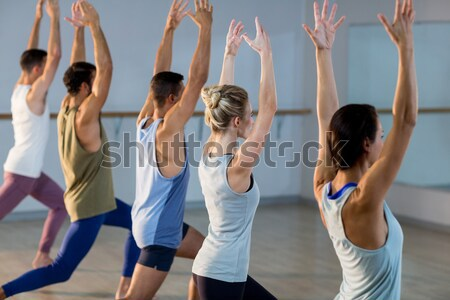 Group of fitness team performing stretching exercise Stock photo © wavebreak_media