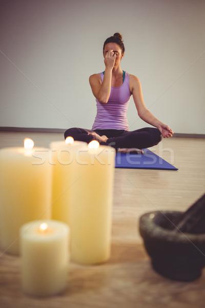 Woman doing meditation on exercise mat Stock photo © wavebreak_media