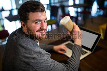 Frustrated businessman sitting in office Stock photo © wavebreak_media