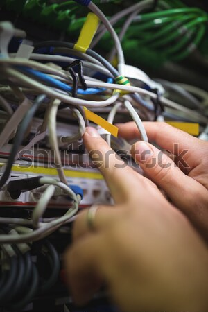 Technician plugging patch cable in a rack mounted server Stock photo © wavebreak_media