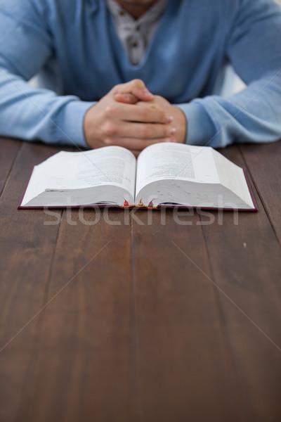 человека Библии сидят столе ноутбук весело Сток-фото © wavebreak_media