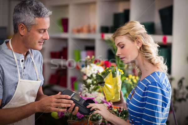 Woman making payment with her credit card to florist Stock photo © wavebreak_media