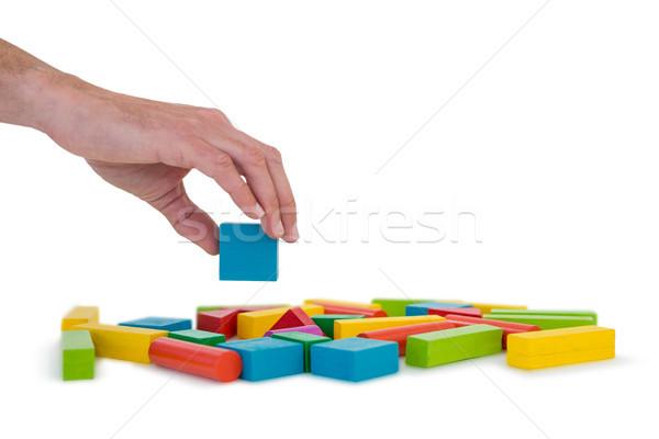 Hand arranging building blocks Stock photo © wavebreak_media