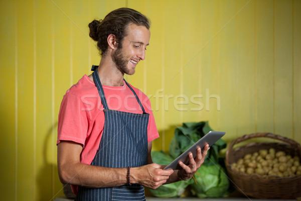 Smiling male staff using digital tablet in organic section Stock photo © wavebreak_media
