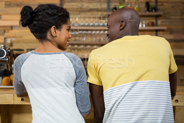 Rear view of couple looking at each other in coffee shop Stock photo © wavebreak_media