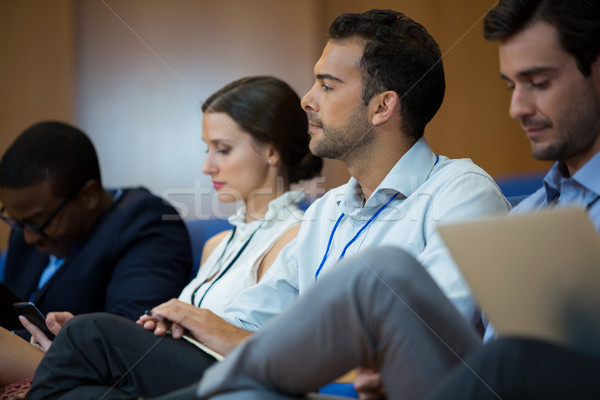 Business executives participating in a business meeting using electronic devices Stock photo © wavebreak_media