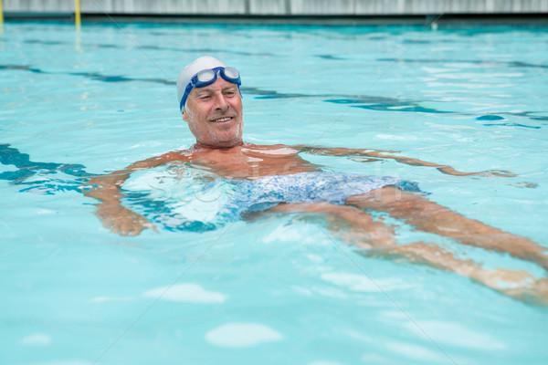 Senior man swimming in pool Stock photo © wavebreak_media