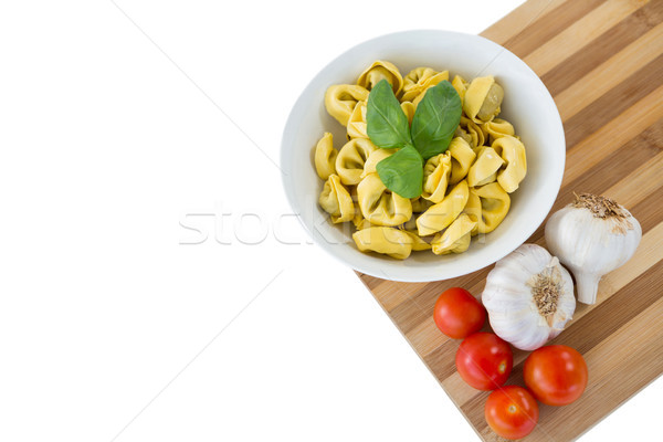High angle view of pasta served in bowl on cutting board Stock photo © wavebreak_media