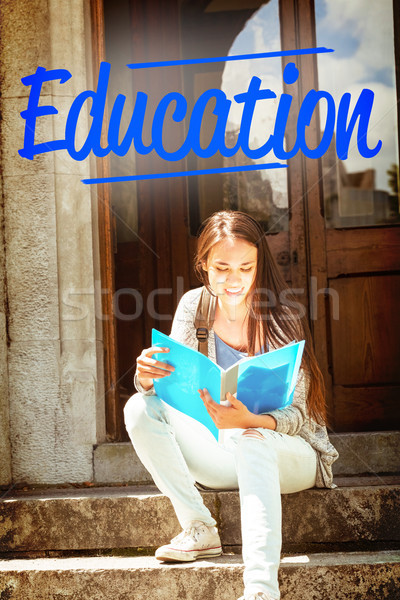 Education against smiling student sitting and reading book Stock photo © wavebreak_media