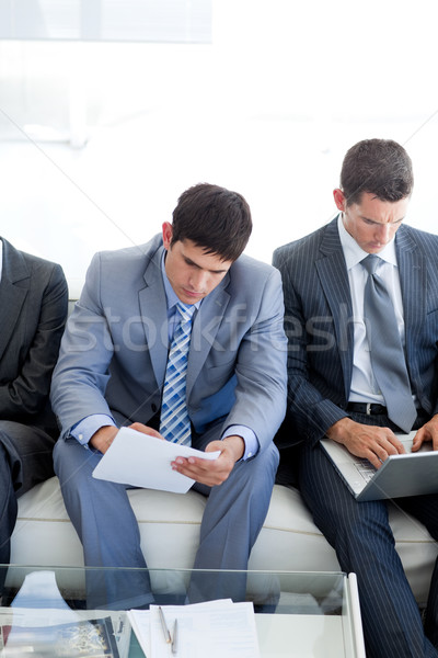 Stock photo: Concentrated Business people sitting and waiting for a job inter