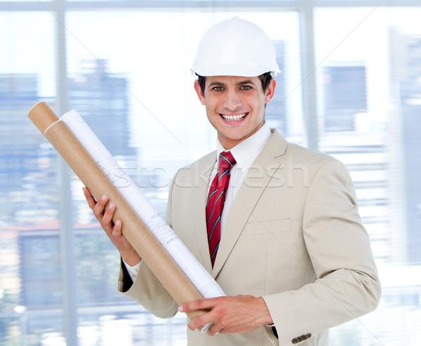 Confident architect holding a blueprint Stock photo © wavebreak_media