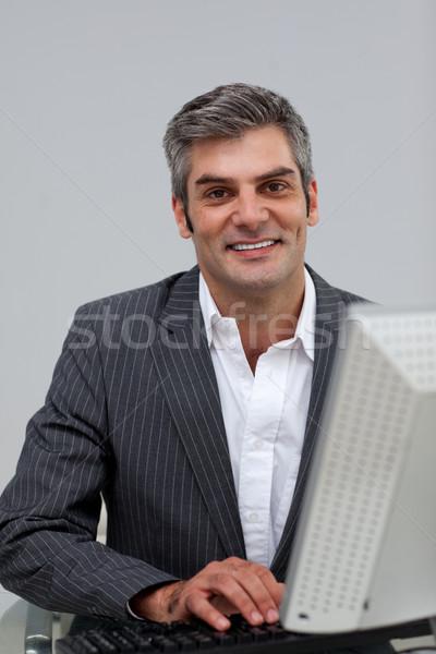 Self-assured male executive working at a computer Stock photo © wavebreak_media