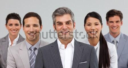 Souriant gestionnaire permanent équipe blanche affaires Photo stock © wavebreak_media