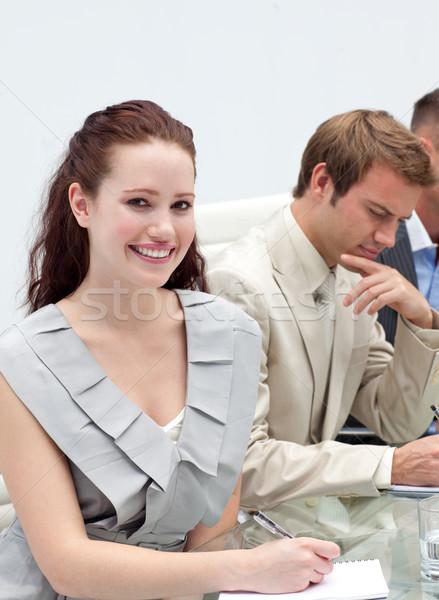 Bájos üzletasszony készít jegyzetek megbeszélés boldog Stock fotó © wavebreak_media