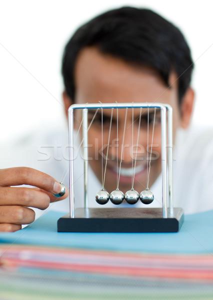 Young businessman having fun with kinetic balls Stock photo © wavebreak_media