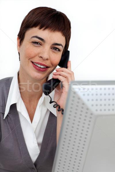 Assertive Businesswoman on phone at her desk  Stock photo © wavebreak_media