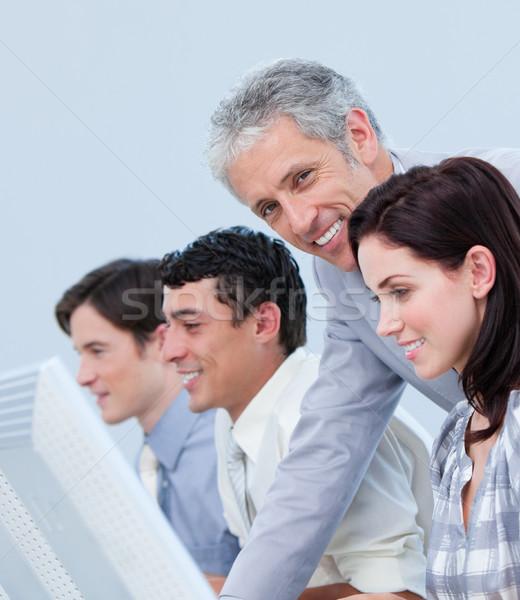 Assertive mature manager checking his employee's work Stock photo © wavebreak_media