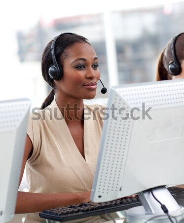 Stock photo: Female customer service agent in a call center