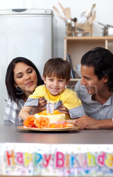 Smiling parents celebrating their son's birthday Stock photo © wavebreak_media