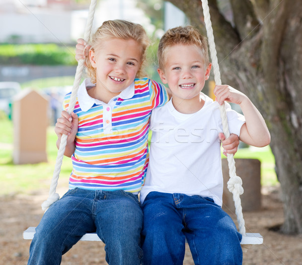 Cute siblings swinging  Stock photo © wavebreak_media