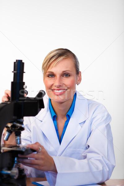 Bilim adamı mikroskop gülen kamera laboratuvar Stok fotoğraf © wavebreak_media