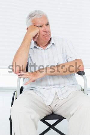 Upset senior woman with a neck brace sitting on a wheelchair Stock photo © wavebreak_media