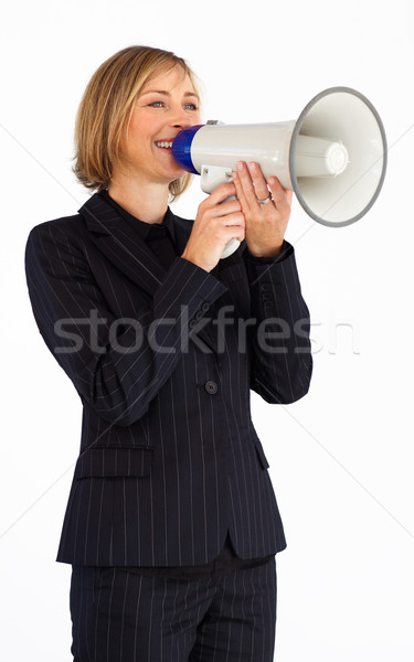 Blonde businesswoman speaking into a megaphone Stock photo © wavebreak_media