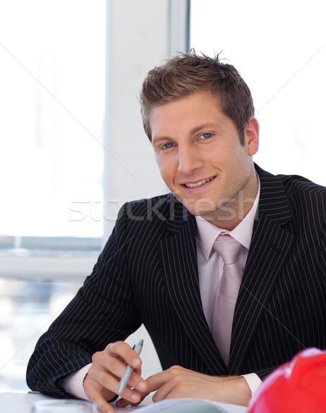 Young Engineer looking at Blueprints Stock photo © wavebreak_media