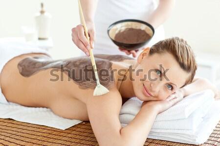 Szczęśliwy kobieta błoto leczenia skóry spa Zdjęcia stock © wavebreak_media