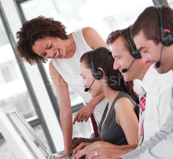 Sorridente feminino gerente venda representante trabalho em equipe Foto stock © wavebreak_media