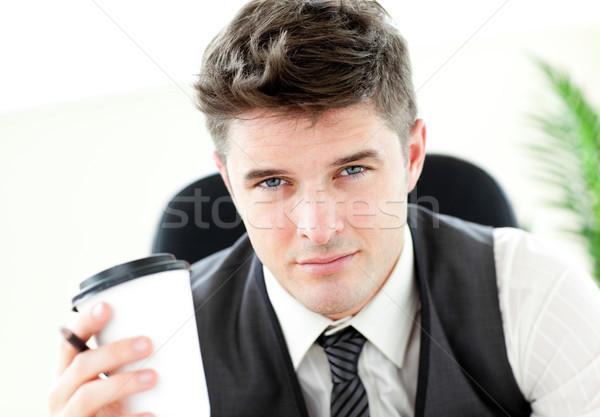 Poważny biznesmen pitnej kawy biuro biały Zdjęcia stock © wavebreak_media