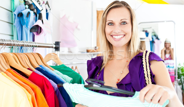 Caucasian woman selecting item in a clothes shop Stock photo © wavebreak_media