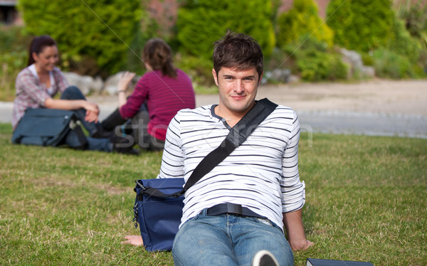Good-looking male student lying on the grass with his schoolbag at his university campus Stock photo © wavebreak_media