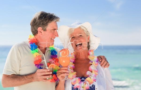 Elderly couple drinking a cocktail on the beach Stock photo © wavebreak_media