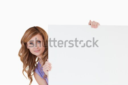 Cute blond-haired woman holding a white board Stock photo © wavebreak_media