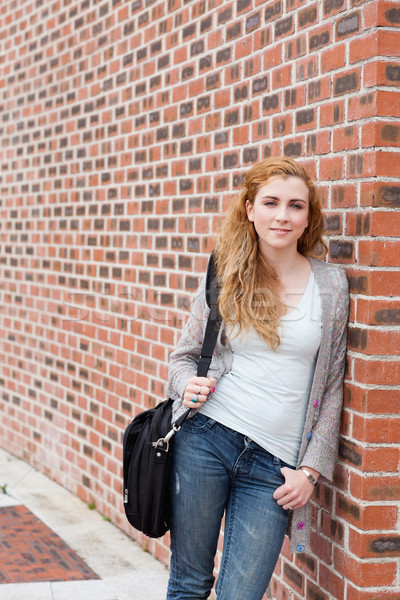Portrait of a cute student standing up outside a buiding Stock photo © wavebreak_media