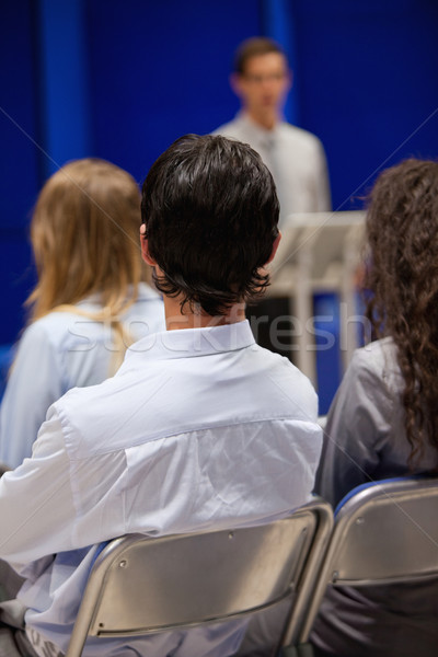 Portrait of young people listening to a man doing a presentation Stock photo © wavebreak_media