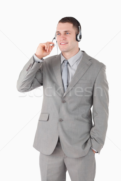 Portrait of an operator using a headset against a white background Stock photo © wavebreak_media