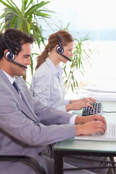 Jeunes hotline travaux technologie clavier Photo stock © wavebreak_media