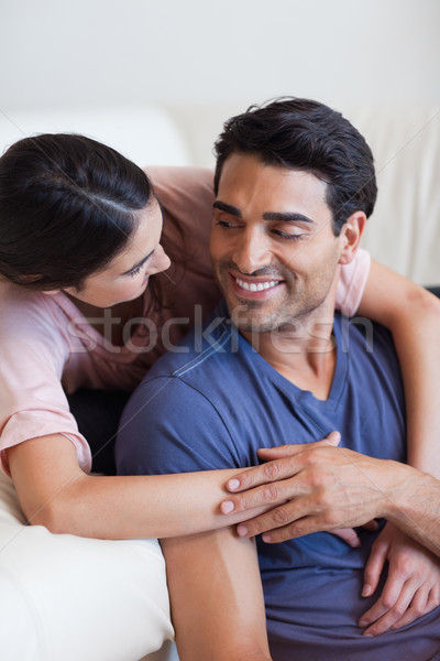 Portrait of a charming couple posing in their living room Stock photo © wavebreak_media