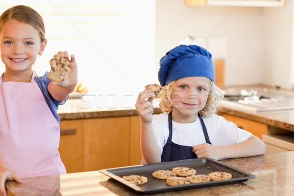Siblings holding their cookies up Stock photo © wavebreak_media