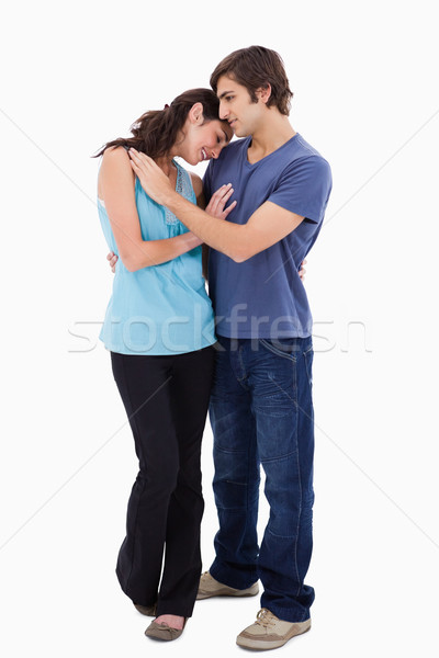 Portrait of a lovely couple embracing each other against a white background Stock photo © wavebreak_media