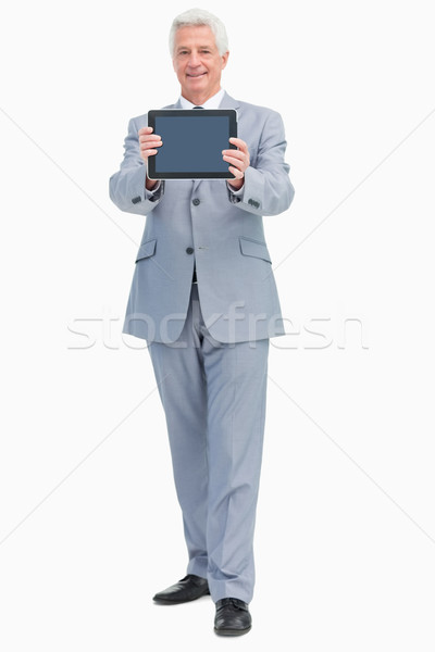 Boss showing a touch Pad screen against white background Stock photo © wavebreak_media