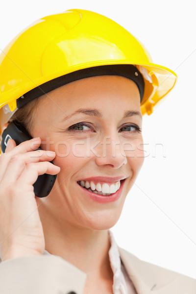 Portré nő telefonál visel védősisak fehér üzlet Stock fotó © wavebreak_media