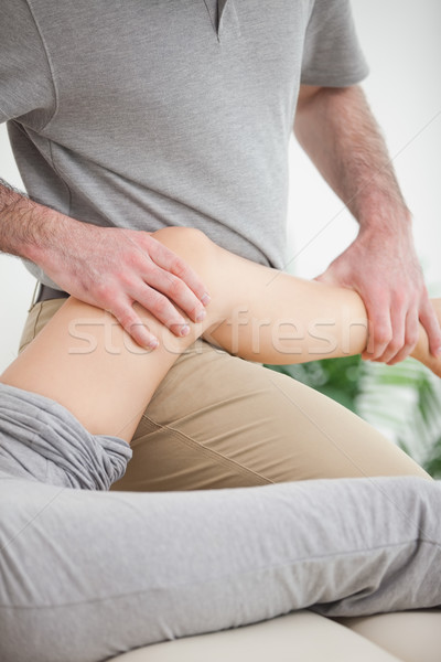 Leg of a patient being placed on the doctor in a room Stock photo © wavebreak_media