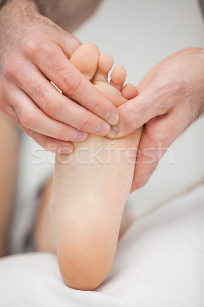 Foot being touched by a chiropodist in a room Stock photo © wavebreak_media