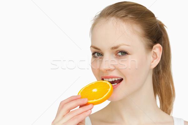 Mulher fatia de laranja boca branco mão laranja Foto stock © wavebreak_media