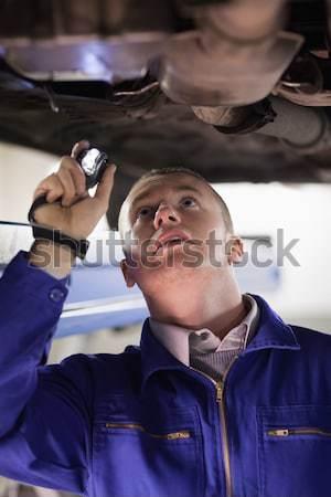Mosolyog szerelő javít alatt autó garázs Stock fotó © wavebreak_media