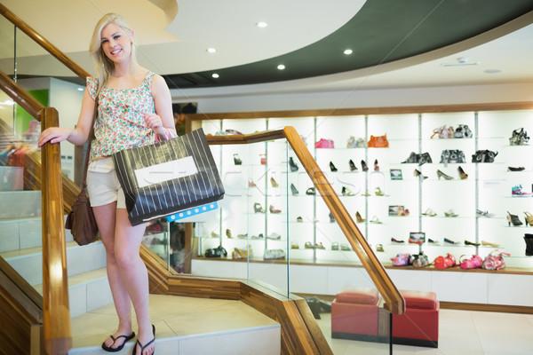 Kadın ayakta merdiven mutlu moda Stok fotoğraf © wavebreak_media